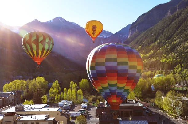 Balloon festival in Telluride Hot Air balloons flying over Town in the morning,Telluride, Colorado, USA, 06.01.2013 stock photo