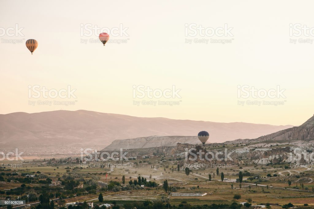 Balloon flight. The famous tourist attraction of Cappadocia is an air flight. Cappadocia is known all over the world as one of the best places for flights with balloons. Cappadocia, Turkey. stock photo