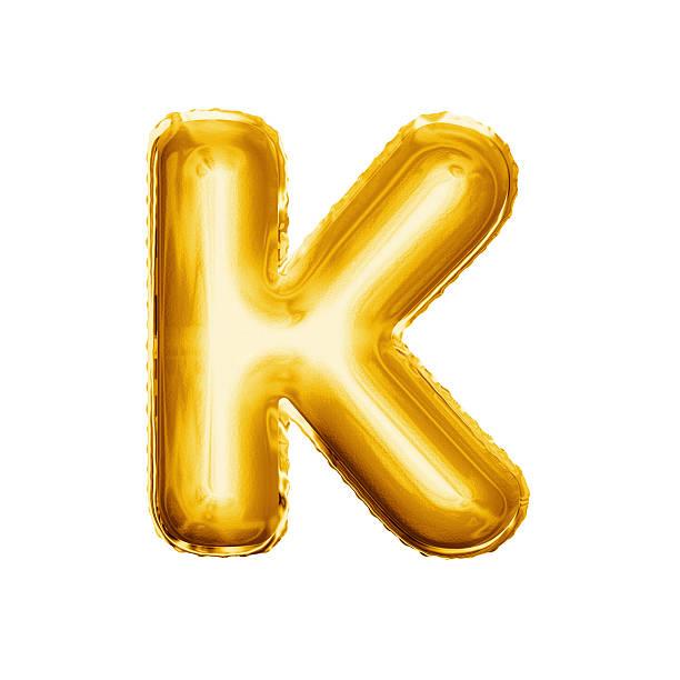 balloon letter k 3d golden foil realistic alphabet - буква k стоковые фото и изображения
