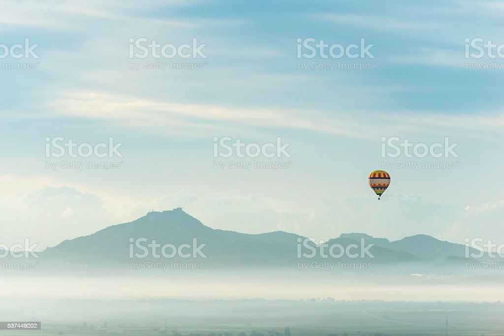 Balloon over fog at the morning stock photo