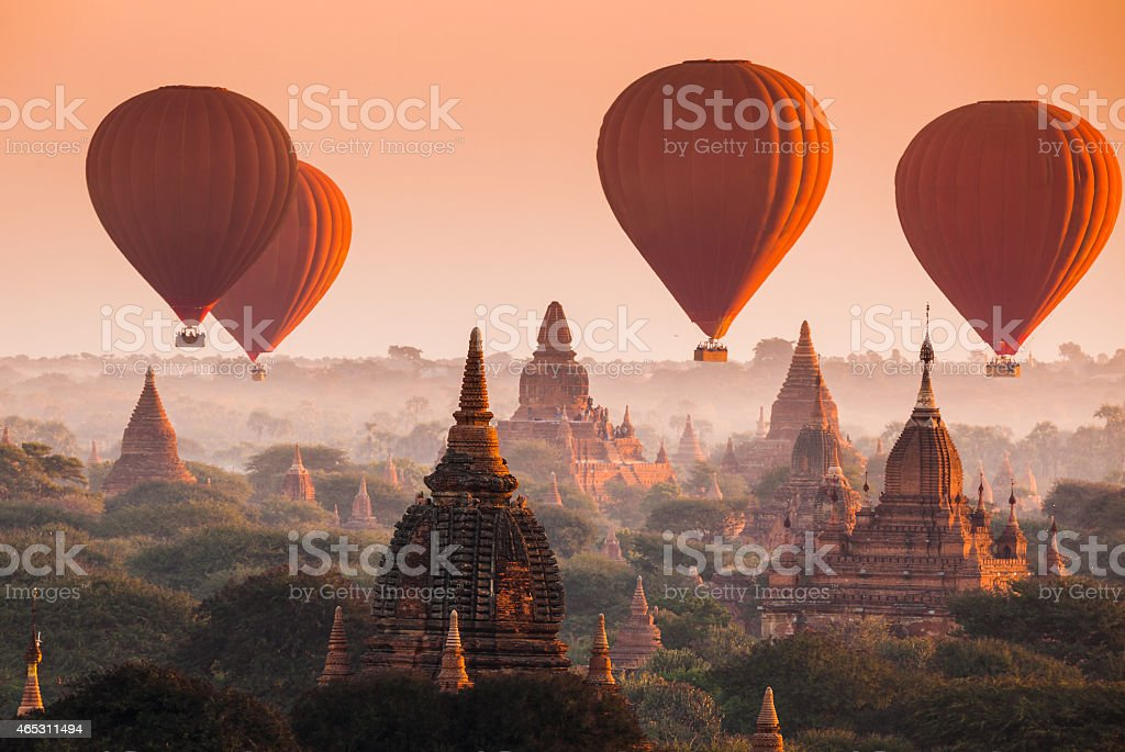Balloon over plain of Bagan in misty morning, Myanmar stock photo