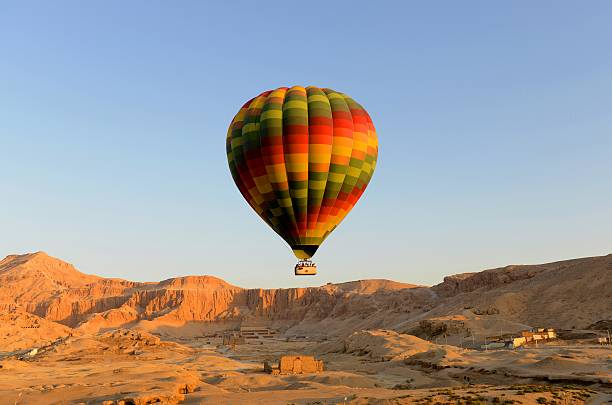 Balloon Hot air balloon lifting off in Egypt. valley of the kings stock pictures, royalty-free photos & images