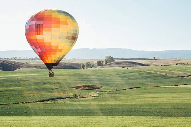 balloon ride through the countryside balloon ride over the field in a spring day on the green grass (Spain) steamboat springs stock pictures, royalty-free photos & images