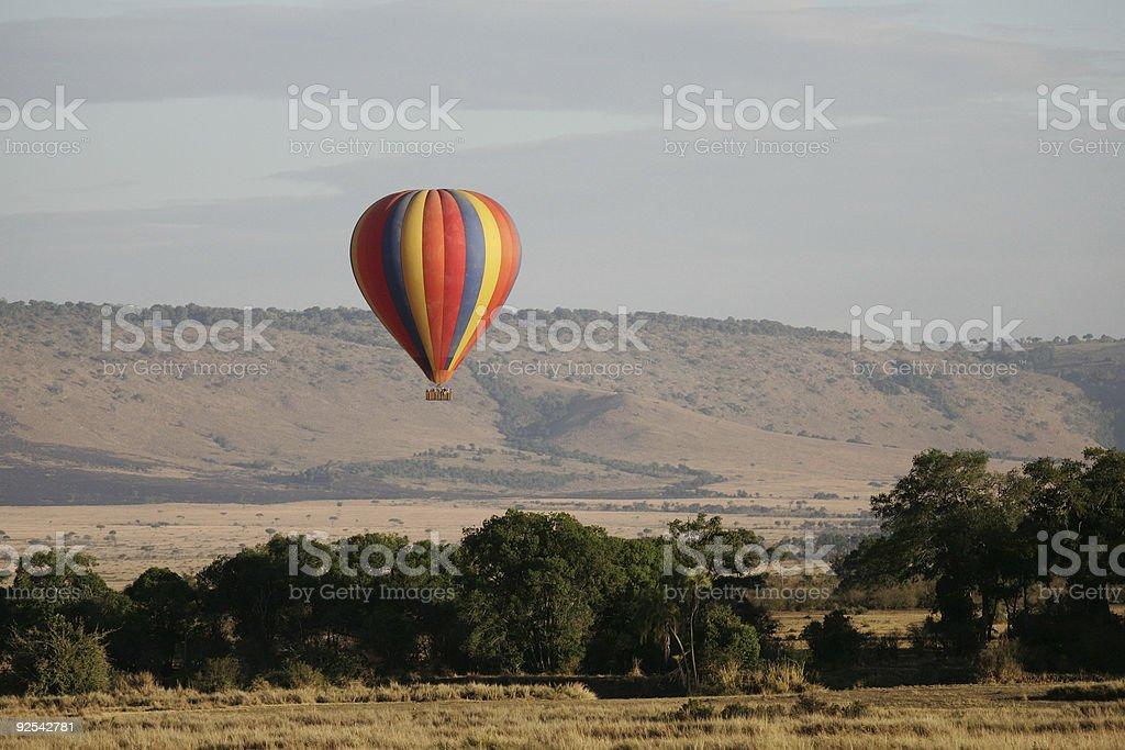 Balloon rising over the Masai Mara stock photo