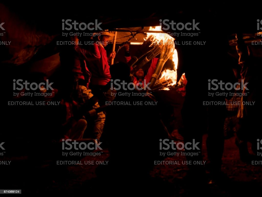 Balloon team staffs putting fire torch under hot air balloon at Taunggyi Balloon Festival 2017. Silhouette and Blurred stock photo
