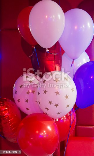 815229514 istock photo Balloon traditional holiday attribute. Every party needs balloons. Happy birthday concept. Celebrate birthday holiday with festive colorful air balloons. Red and white balloons with stars pattern 1209233518