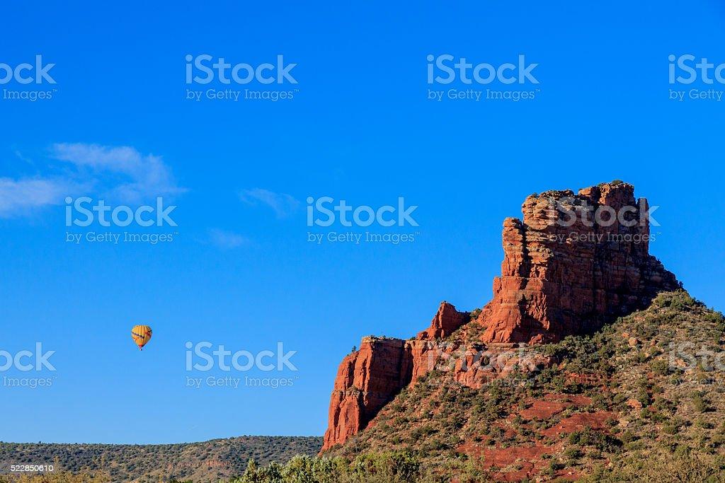 Ballooning near massive sandstone mesa, Sedona, Arizona stock photo