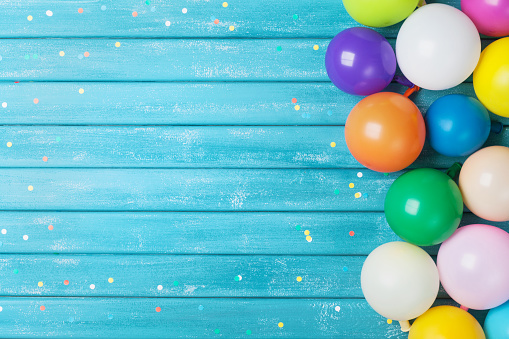 istock Balloons and confetti border. Birthday or party background. Festive greeting card. 883622846
