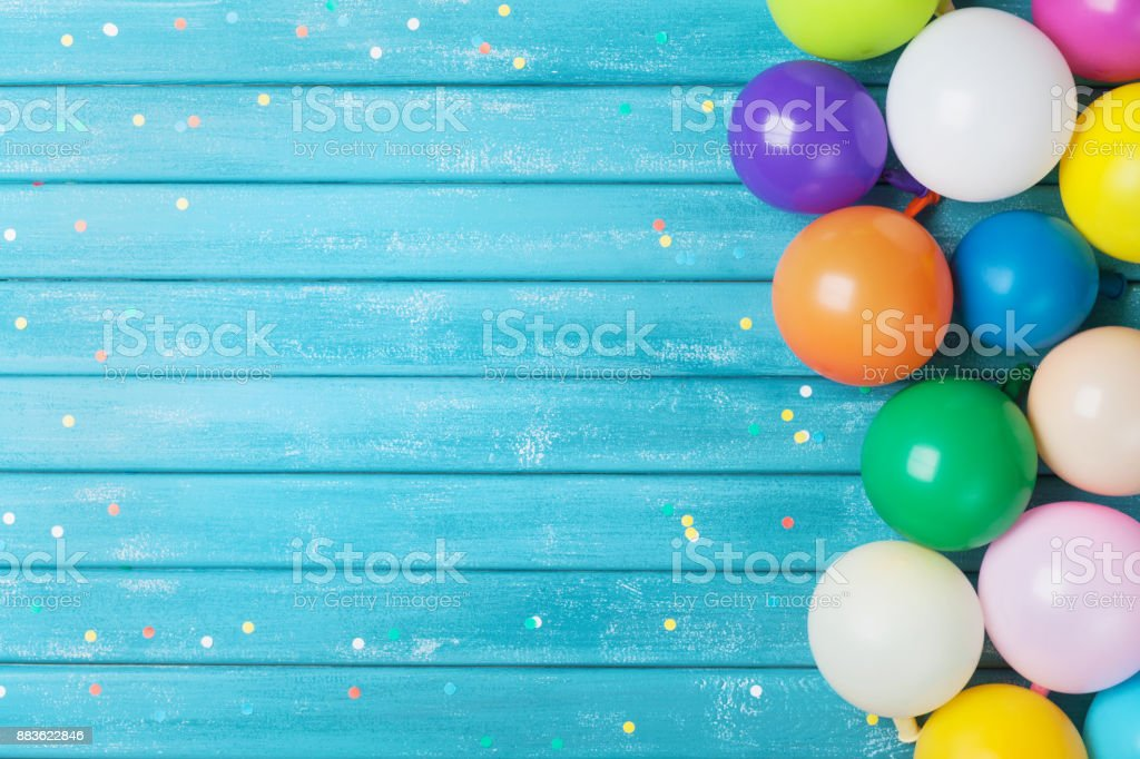 Balloons and confetti border. Birthday or party background. Festive greeting card. stock photo
