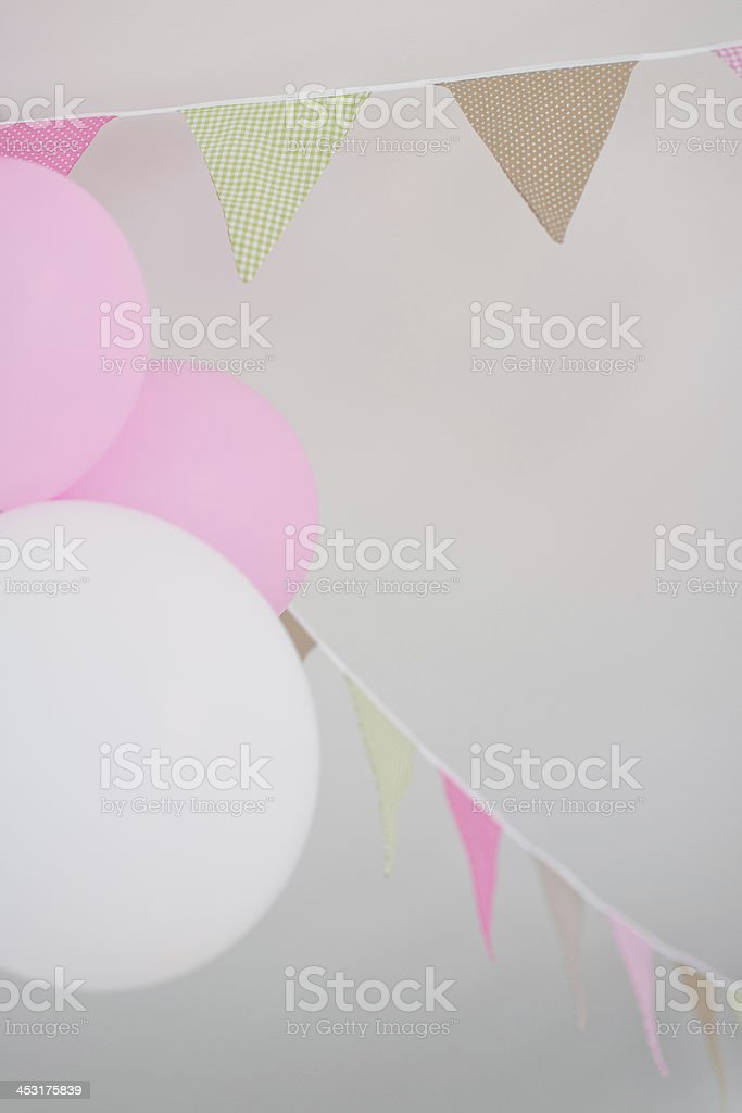 balloons and pennants hanging on cealing stock photo