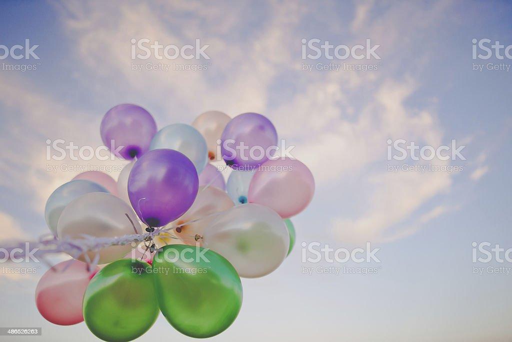 Balloons at sunset stock photo