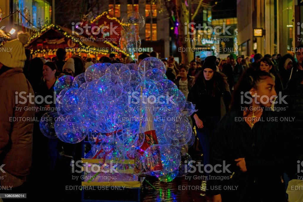 Transparent children\'s balloons filled with led lights at Christmas,...