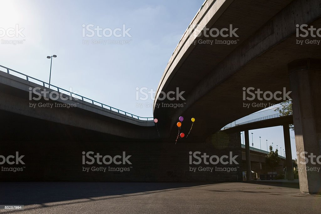 Balloons floating in urban setting royalty-free stock photo