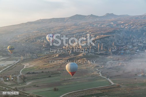istock balloons floats through the morning mist in Turkey 531925423