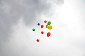 istock Balloons flying into the sky. 1266581966