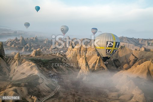 istock balloons gliding over a misty landscape of Göreme in Turkey 532025923