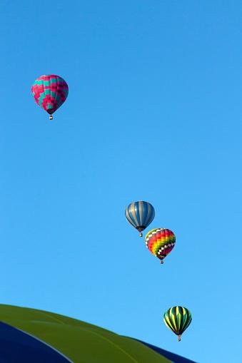Four hot air balloons in flight in Albuquerque, New Mexico