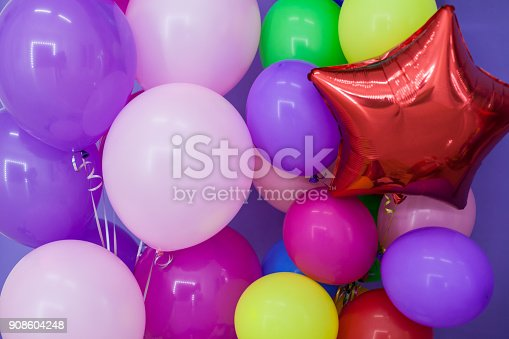 815229514 istock photo balloons of different colors and birthday gifts for the holiday 908604248