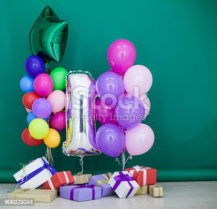 815229514 istock photo balloons of different colors with gifts for the holiday 906325044