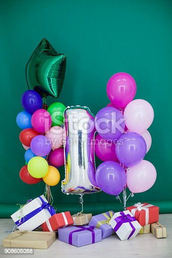 815229514 istock photo balloons of different colors with gifts for the holiday 908605088