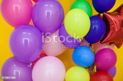 815229514 istock photo balloons of different colors with gifts for the holiday 910807088