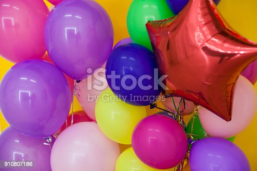 815229514 istock photo balloons of different colors with gifts for the holiday 910807186