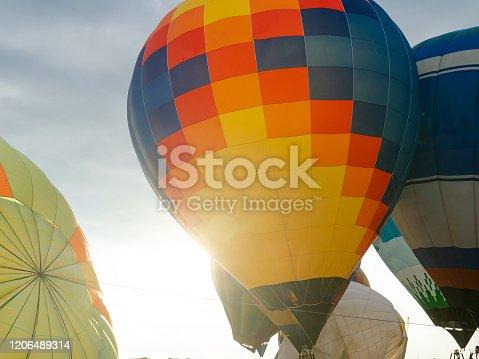 844061492 istock photo Balloons on the ground. Balloonists prepare the balloons for flight. Festival of aeronautics. 1206489314