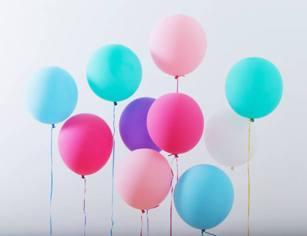 balloons on white wooden background stock photo