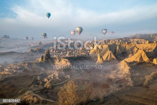 istock balloons over a valley hit by beams of the sunrise 531925447