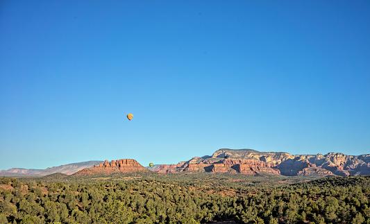 Hot air balloons over red rocks of Sedona, Arizona.