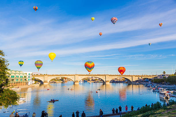Balloons over the Bridge Multiple hot air balloons ascend over the London Bridge, in Lake Havasu City Arizona, during the annual the air balloon festival.  2014 stock pictures, royalty-free photos & images