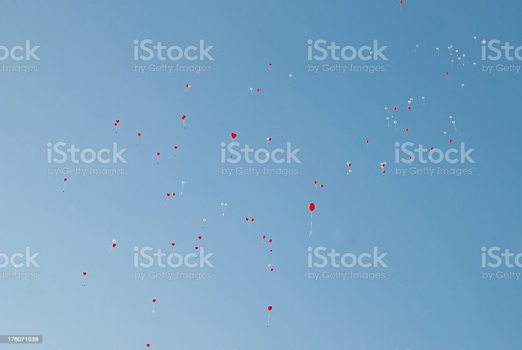 balloons red and white on wedding in blue sky stock photo