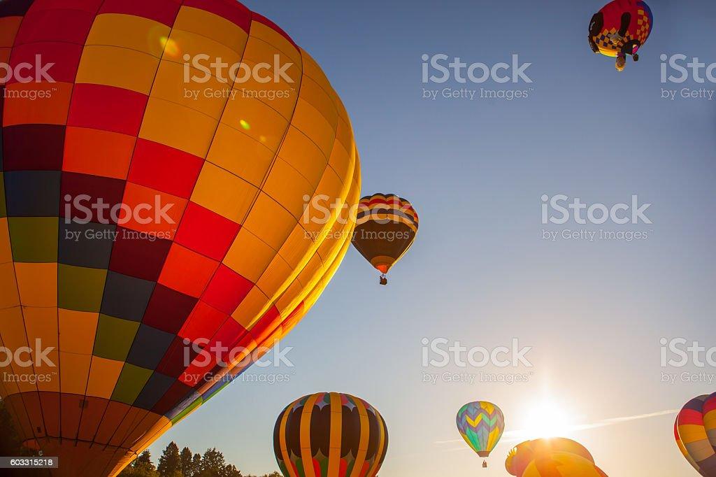 Balloons rising at sunrise. stock photo