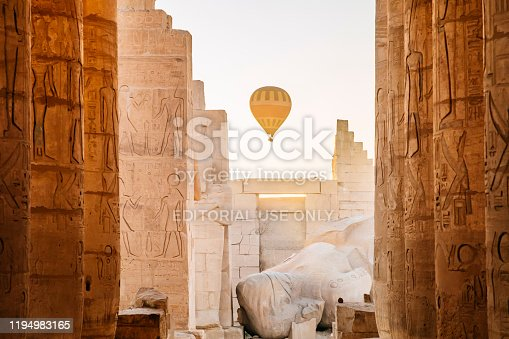 A balloon ride on the west bank of the Nile at dawn is very popular with tourists. The Ramesseum is the memorial temple of Pharaoh Ramesses II, Luxor, Egypt, 29th November 2019