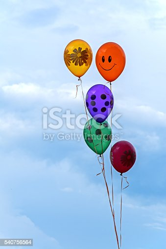 Air balloons with helium on blue sky background