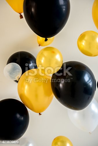 istock balloons yellow and black color on backdrop 623826620