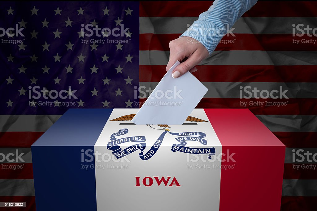 Ballot Box - Election - Iowa, USA A hand casting a vote in a ballot box for an election in the Iowa, USA Activity Stock Photo