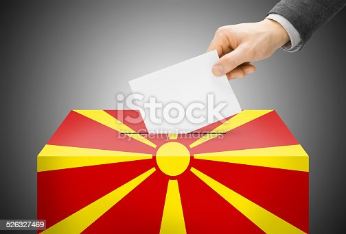 935056316istockphoto Ballot box painted as flag - Republic of Macedonia 526327469