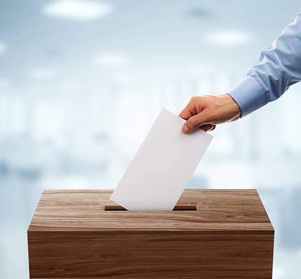 ballot box - voting hands stockfoto's en -beelden