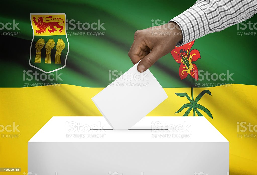 Ballot box with Canadian province flag on background - Saskatchewan stock photo