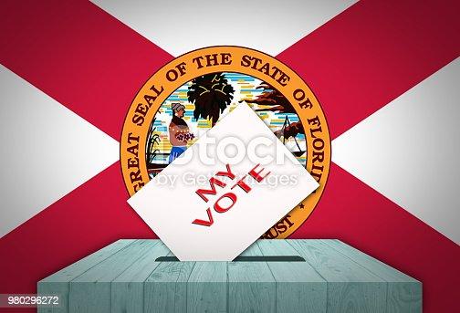 1001757106 istock photo Ballot box with national flag on background - FLORIDA, USA 980296272