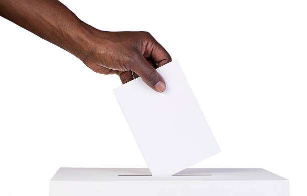 Ballot box with person casting vote stock photo