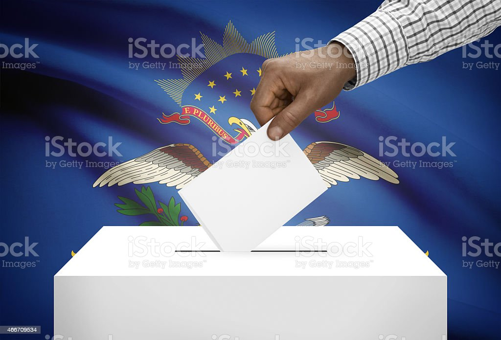 Ballot box with US state flag on background. North Dakota stock photo