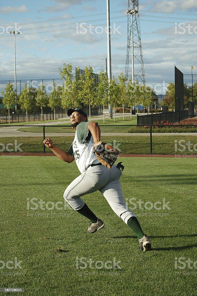 Ballplayer Runs For Ball stock photo