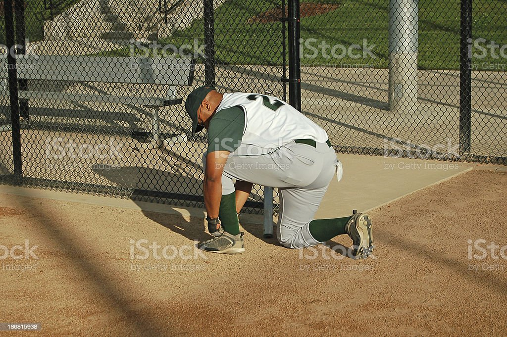Ballplayer Ties Shoes royalty-free stock photo