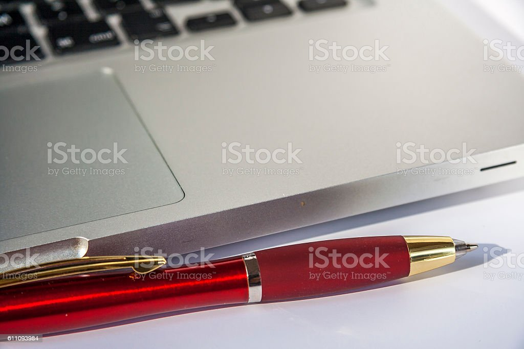 Ballpoint Pen And Laptop stock photo