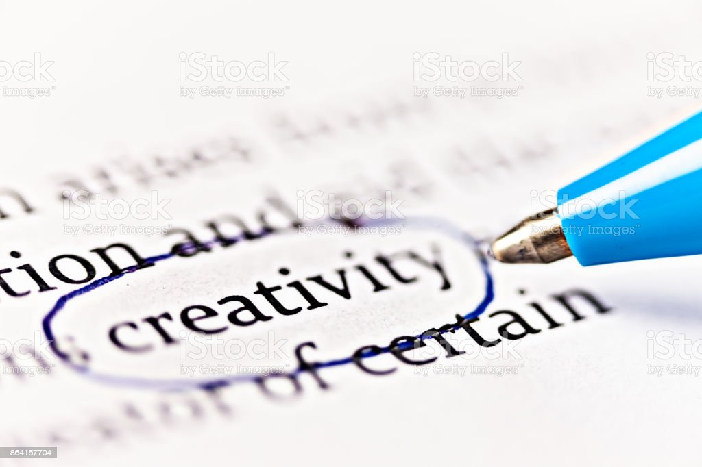 Ballpoint pen circles word 'creativity' in printed document royalty-free stock photo