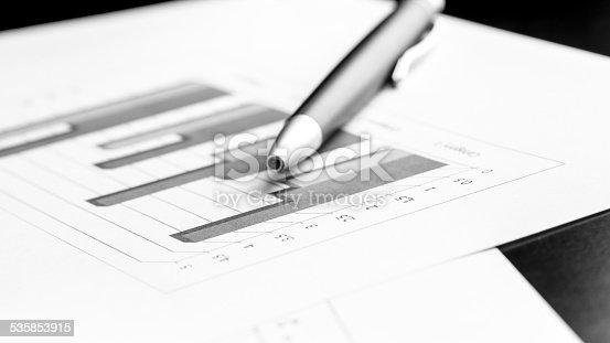 istock Ballpoint pen lying on a bar graph 535853915