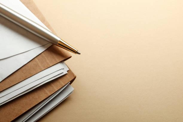 Ballpoint Pen On Stack Of File Folders stock photo