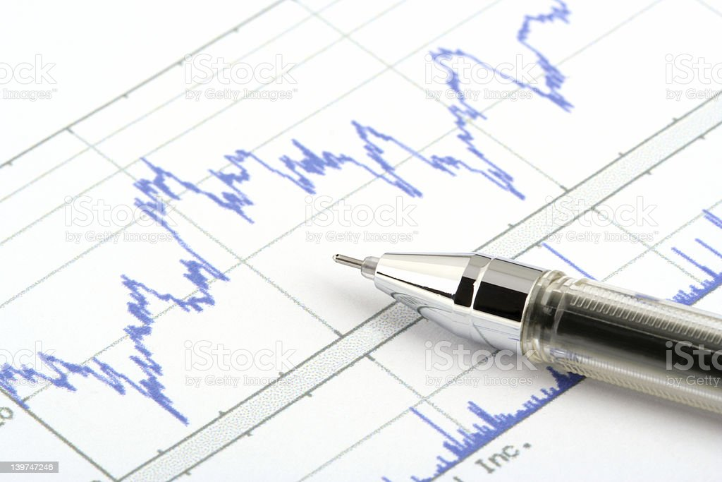 ballpoint pen on stock chart royalty-free stock photo